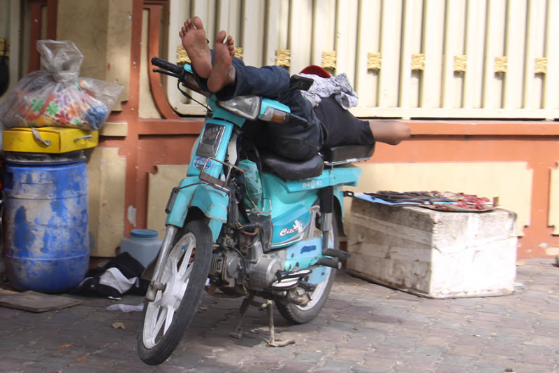 Nap time for a moto driver in Phnom Penh