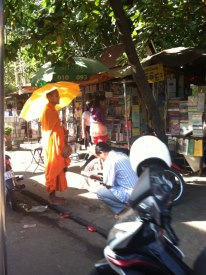 A monk in Phnom Penh making his daily round of collecting alms for the poor