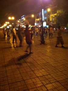 Cambodian citizens participating in a group dance/ aerobic workout on the streets of Phnom Penh