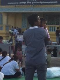 Young people gathering outside the palace in Phnom Penh